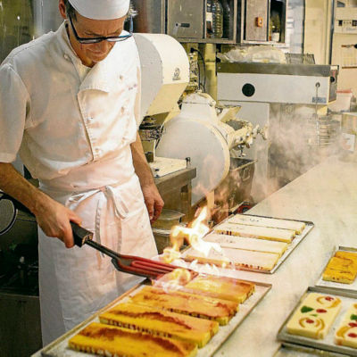 chef flaming the top of the yema turron to caramelize it